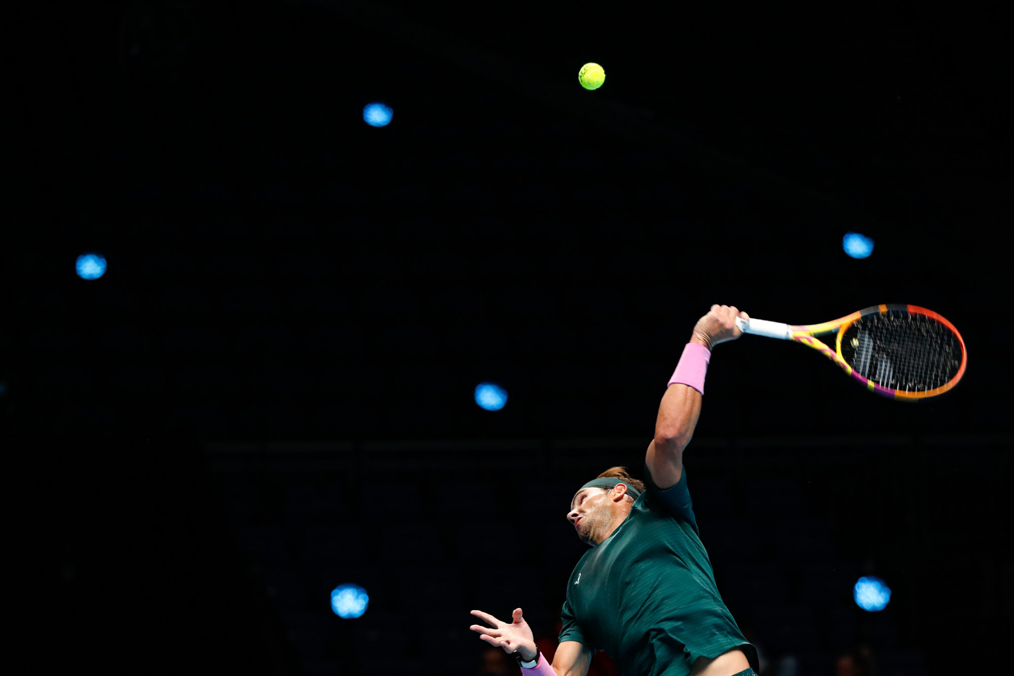 Rafael Nadal of Spain serves to Stefanos Tsitsipas of Greece during their tennis match at the ATP World Finals tennis tournament at the O2 arena in London on Nov. 19, 2020. (AP Photo/Frank Augstein)