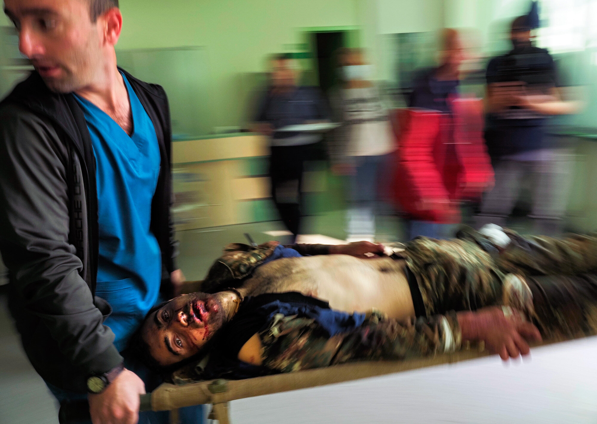 Medical workers transport a wounded man in a hospital during shelling by Azerbaijan's artillery in Stepanakert, in the separatist region of Nagorno-Karabakh, on Oct. 28, 2020. (AP Photo/Dmitry Lovetsky)