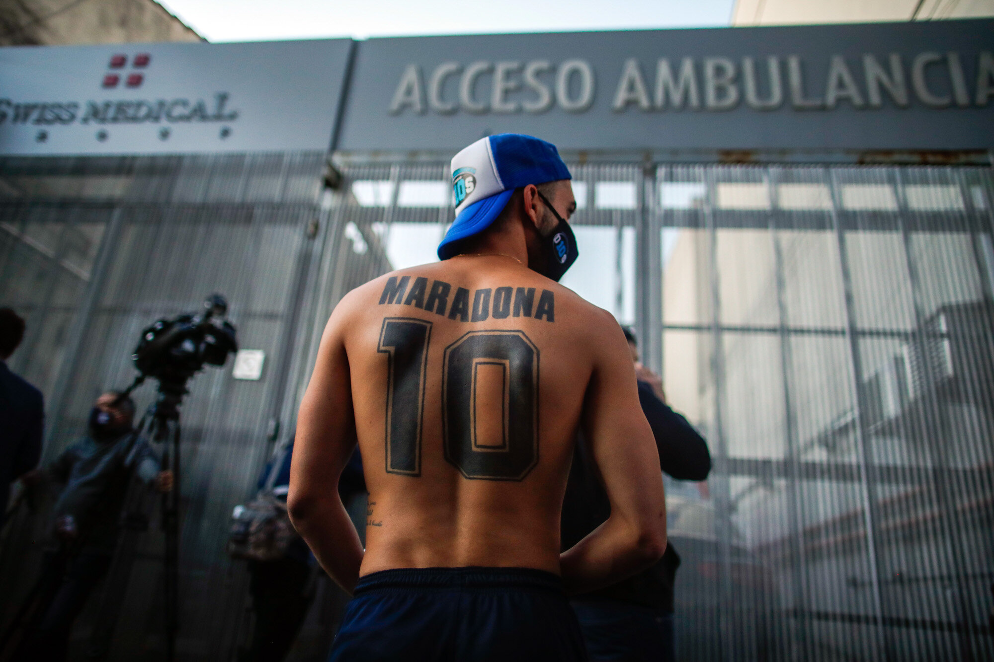 Soccer fans gather outside Clinica Olivos, where former soccer star Diego Maradona will undergo surgery, in Buenos Aires, Argentina, on Nov. 3, 2020. Widely regarded as one of the greatest soccer players of all time, Maradona died on Nov. 25. He was 60. (AP Photo/Natacha Pisarenko)