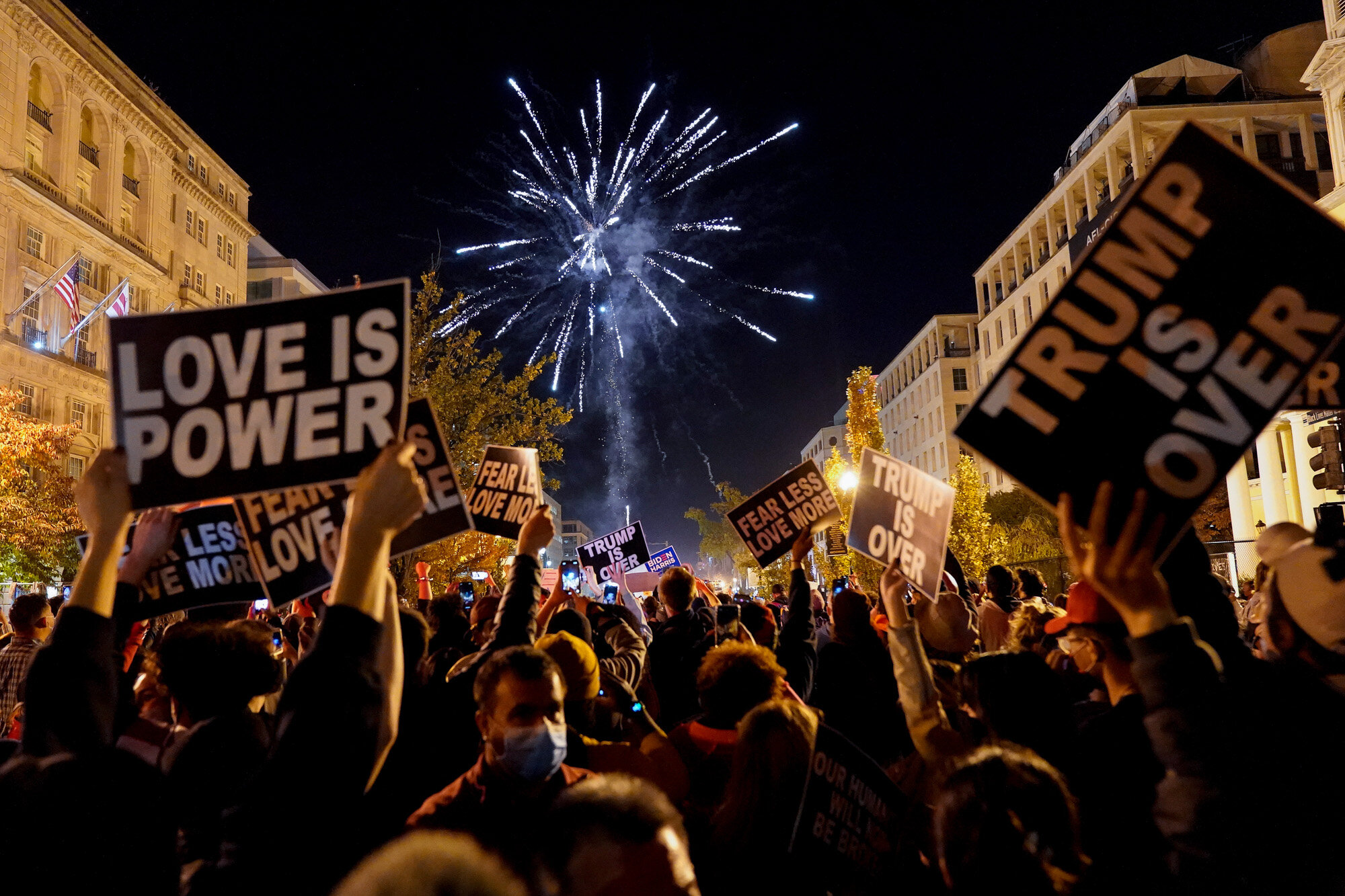 People shoot off fireworks in Washington's Black Lives Matter Plaza while celebrating president-elect Joe Biden's win over President Donald Trump to become the 46th president of the United States on Nov. 7, 2020. (AP Photo/Jacquelyn Martin)