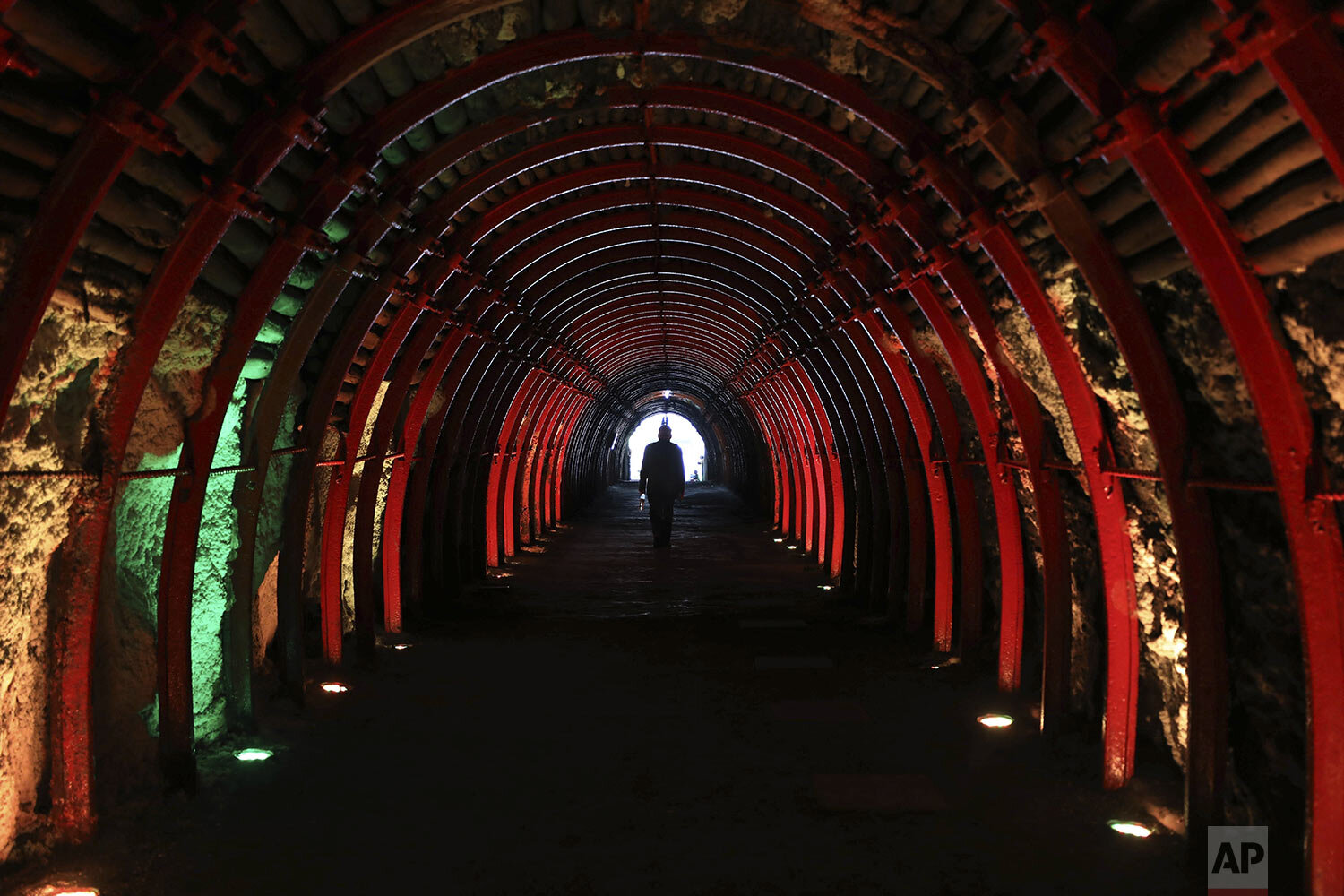 A man exits after touring the underground, New Salt Cathedral in Zipaquira, Colombia, Wednesday, Dec. 16, 2020. Considered the First Wonder of Colombia, the architectural, religious, and salt mining site marked its first 25 years of history in 2020. (AP Photo/Fernando Vergara)