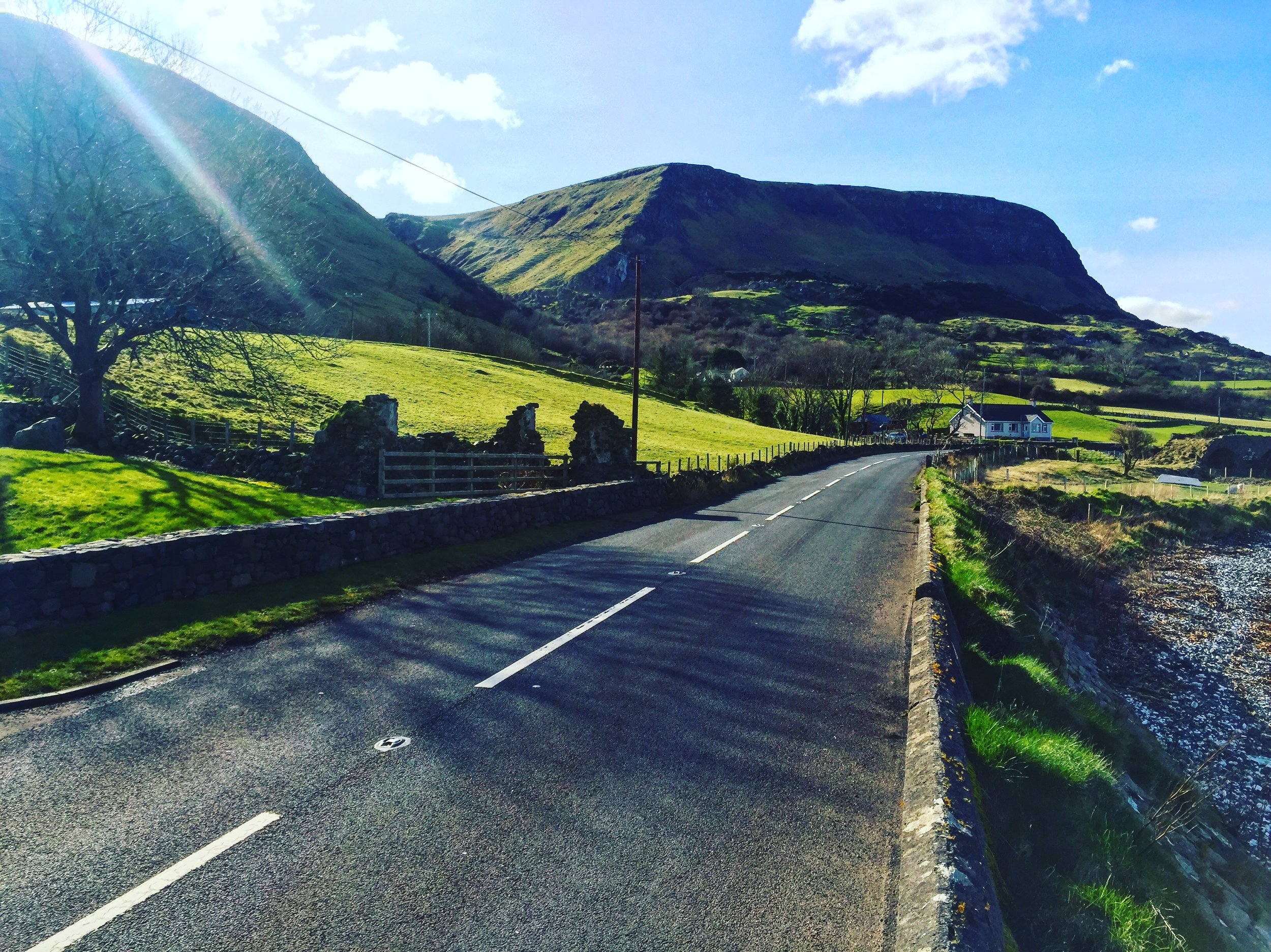 mountains_waterfoot_green_more_gnome_ardclinis_church_ruins_fairy_tree_thorn_roadtrip_causeway_antrim_coast_ni_explorer_niexplorer_northern_ireland_blog.jpg