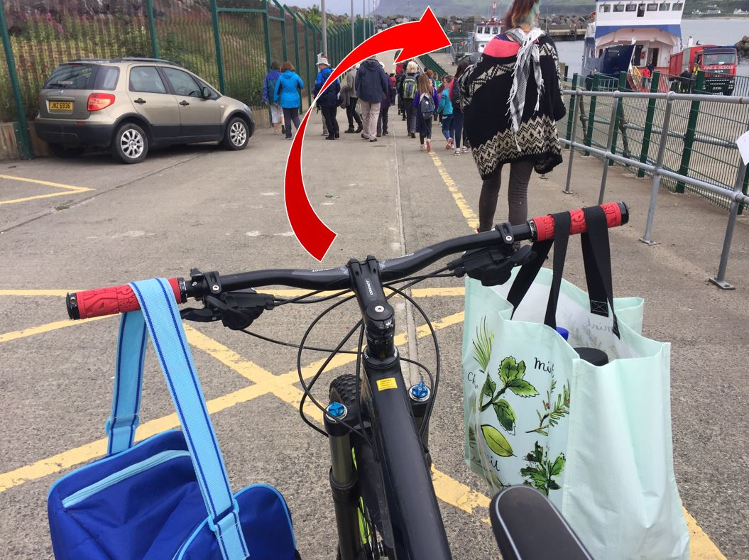 (This arrow's meant to be highlighting the ferry, not the woman's head in front of us)