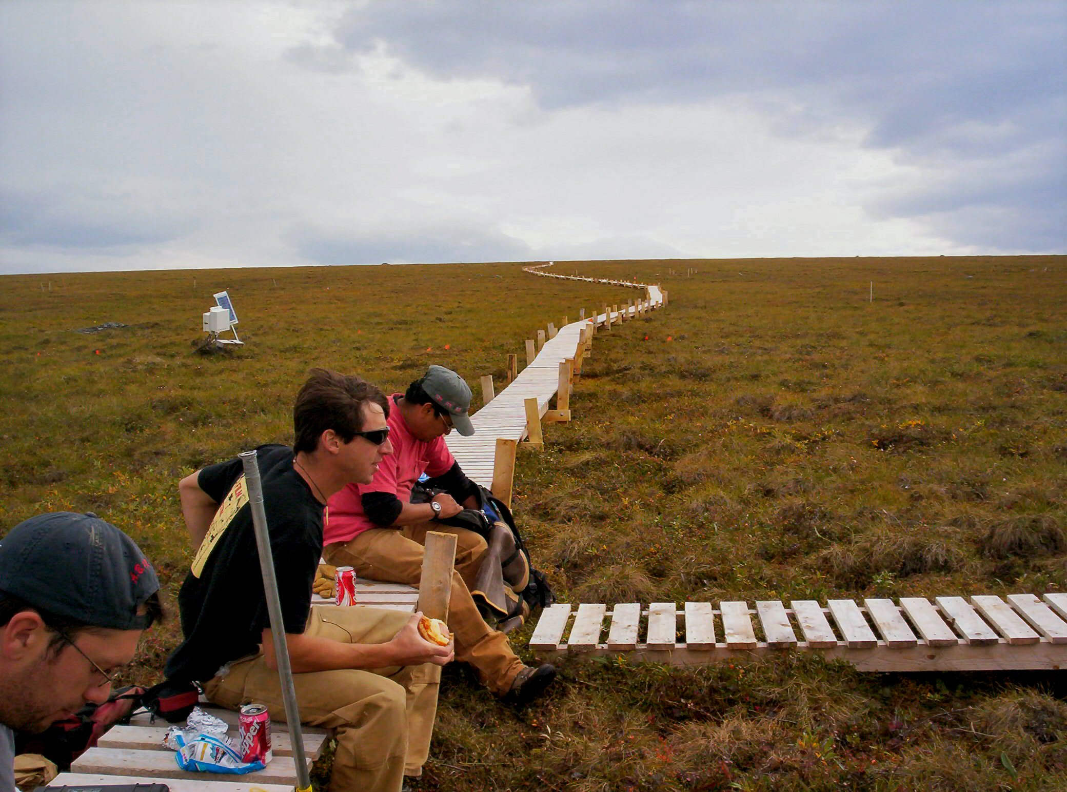Installing an elevated boardwalk near Inuviat Creek in Eastern Alaska so scientists could conduct their research on the tundra without stepping on it.