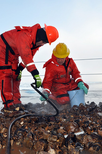 Dr. Alex Andronikov (right), a geologist from the University of Michigan Department of Geological Science, and John Pazol sort through rocks that were dredged from the Arctic Ocean floor. Photo: U.S. Coast Guard petty officer Patrick Kelley