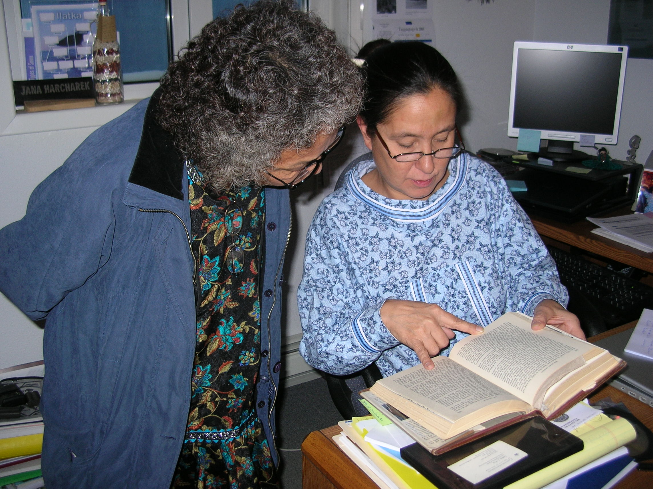nupiaq elder Fannie Akpik and Inupiaq educator Jana Hacharek reading through Laura Boulton's account (Music Hunter) on Barrow, Alaska. Photo: Chie Sakakibara