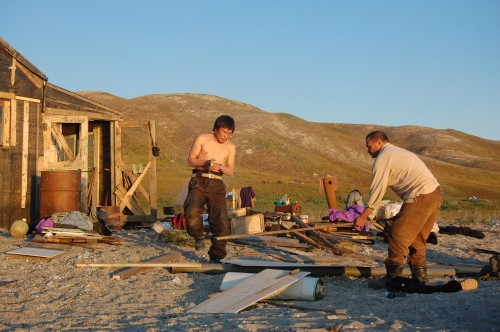 Residents working on a new cabin in Pinakul, a former village site in the Chukotka region.