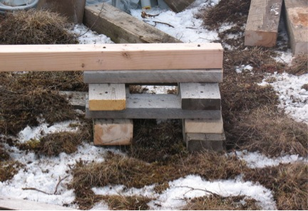 Cribbing is stout, inexpensive and creates a well dispersed footer.