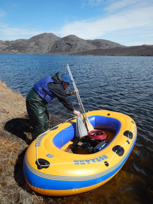 Prepping the inflatable boat before collecting water and diatom samples on a lake in Greenland. University of Maine's Jasmine Saros and a team of graduate students and post-doctorate students are in Greenland this summer investigating diatom assemblages for clues on how climate change may impact Arctic lakes. Photo: Jasmine Saros.