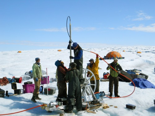 Joel Harper and research team drill bore holes in the Greenland ice sheet using an innovative drill designed by Neil Humphrey. Photo: courtesy Joel Harper