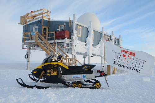An electric snowmobile designed and built by McGill University engineering students. The U.S. National Science Foundation's  Arctic sciences section supports the Clean Snowmobile Contest and manages, in cooperation with the Greenland Government, the clean air/snow research hub Summit Station. The Big House is seen behind the snowmobile. Photo: McGill University Electric Snowmobile Team