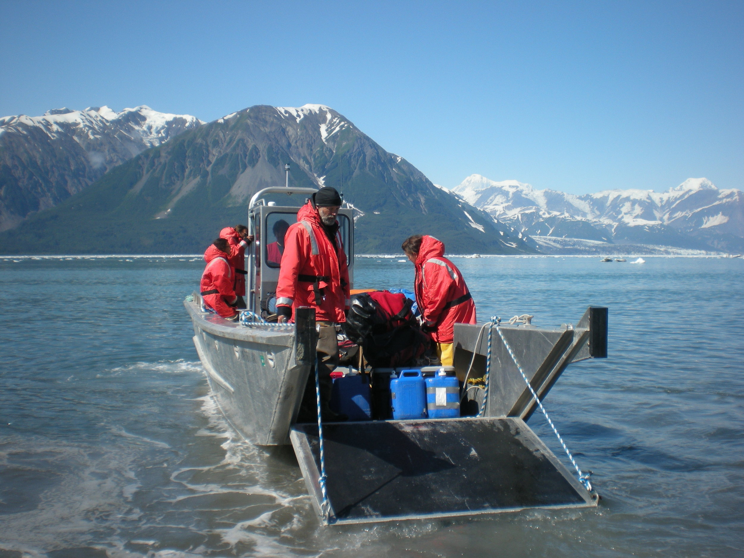 A research team leaves by landing craft for archaeological investigations at Tlaxátà seal camp in Yakutat Bay. Photo: Katherine House