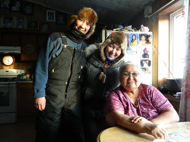 Olga Ulturgasheva (right) and Stacy Rasmus (left) with a village elder in Emmonak Alaska. Photo: Olga Ulturgasheva