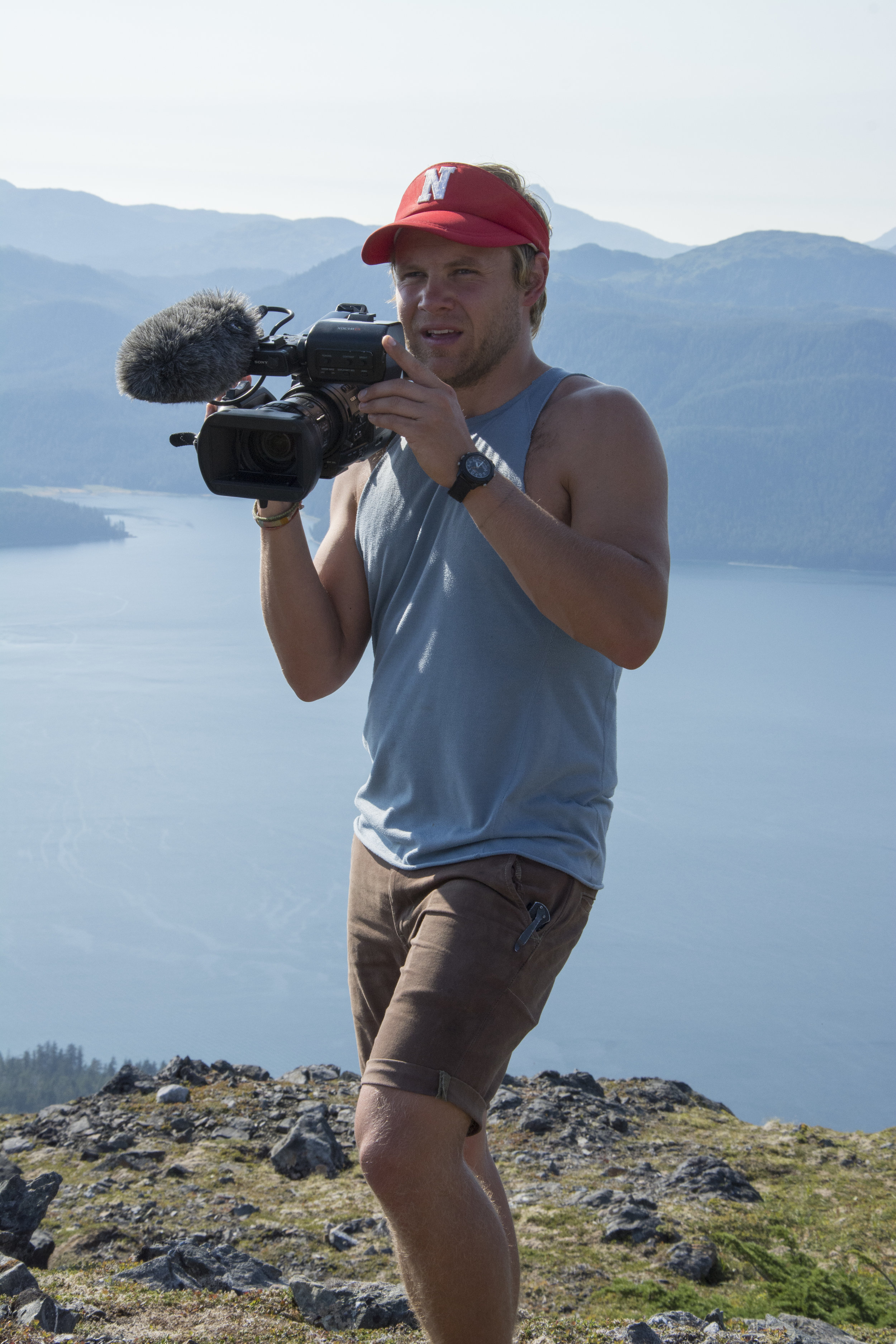 Peter Stegen filming on a ridge in Alaska for his upcoming documentary, Cairns Uncovered. Photo: Peter Stegen