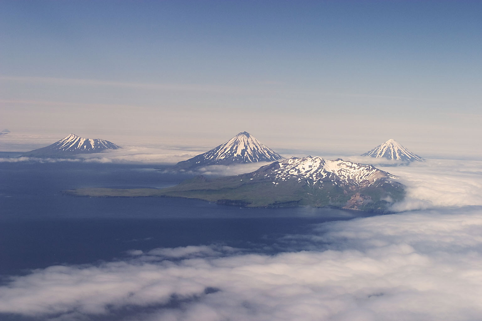 """An aerial photo of the Islands of the Four Mountains. Photo: Ken Wilson, author of """"The Aleutian Islands of AK: Living on the Edge"""""""
