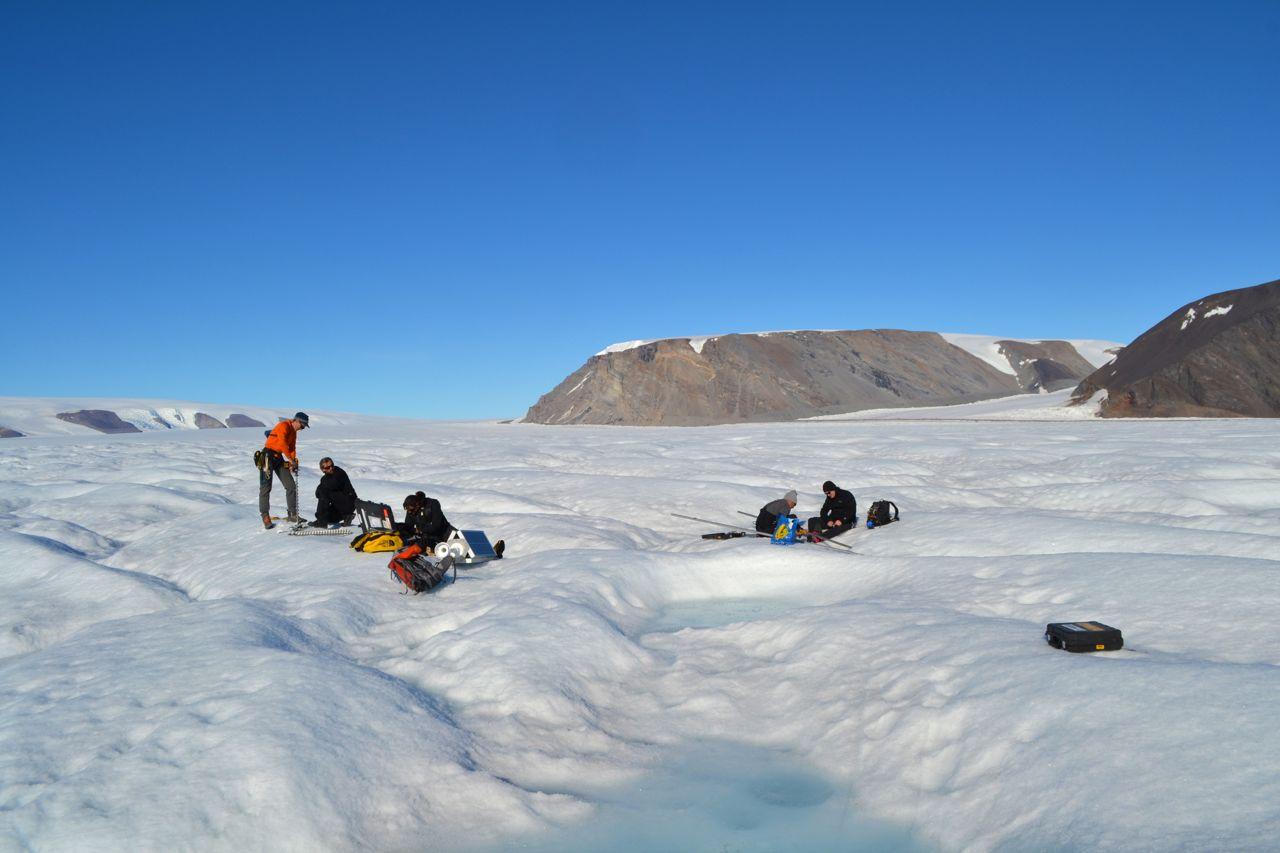 The team installs a GPS station on a glacier. Photo: Lauren Andrews