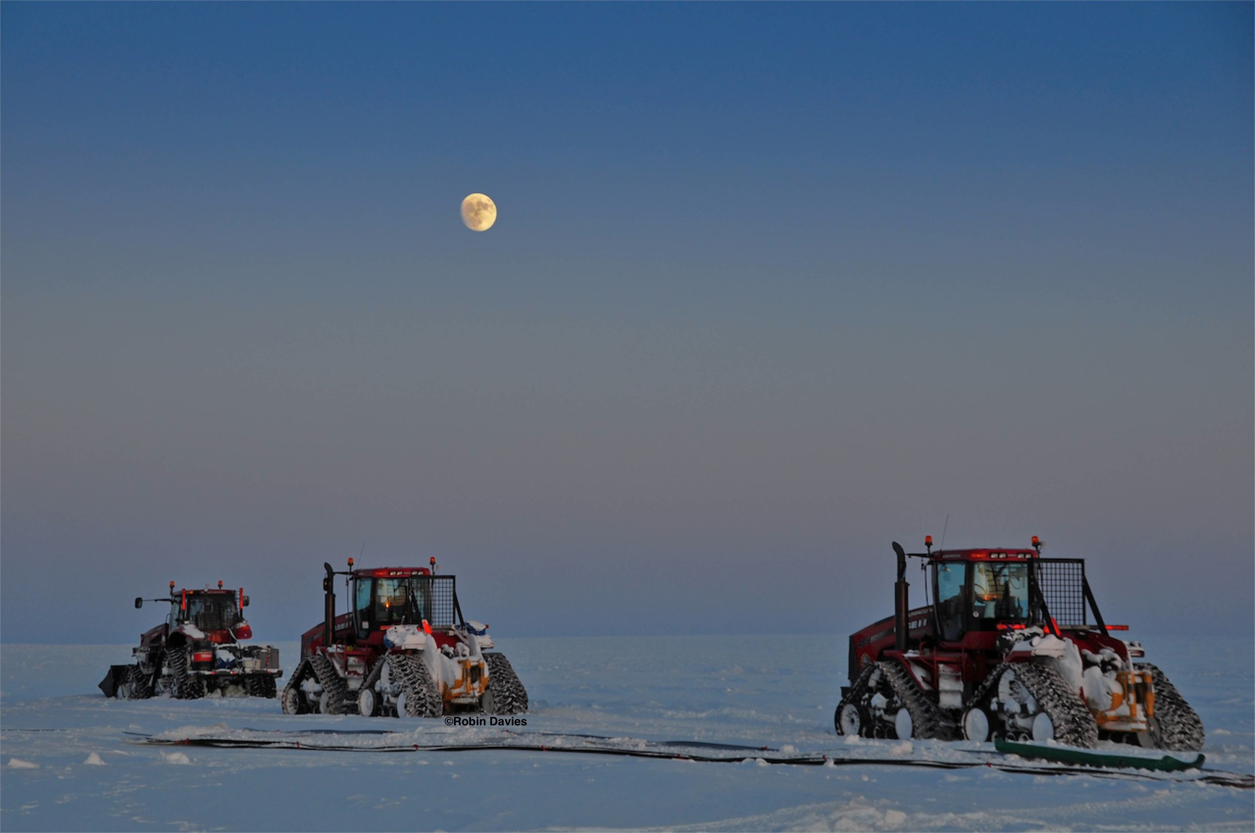 The GrIT fleet parked on the ice sheet under the fading night sky. Photo: Robin Davies