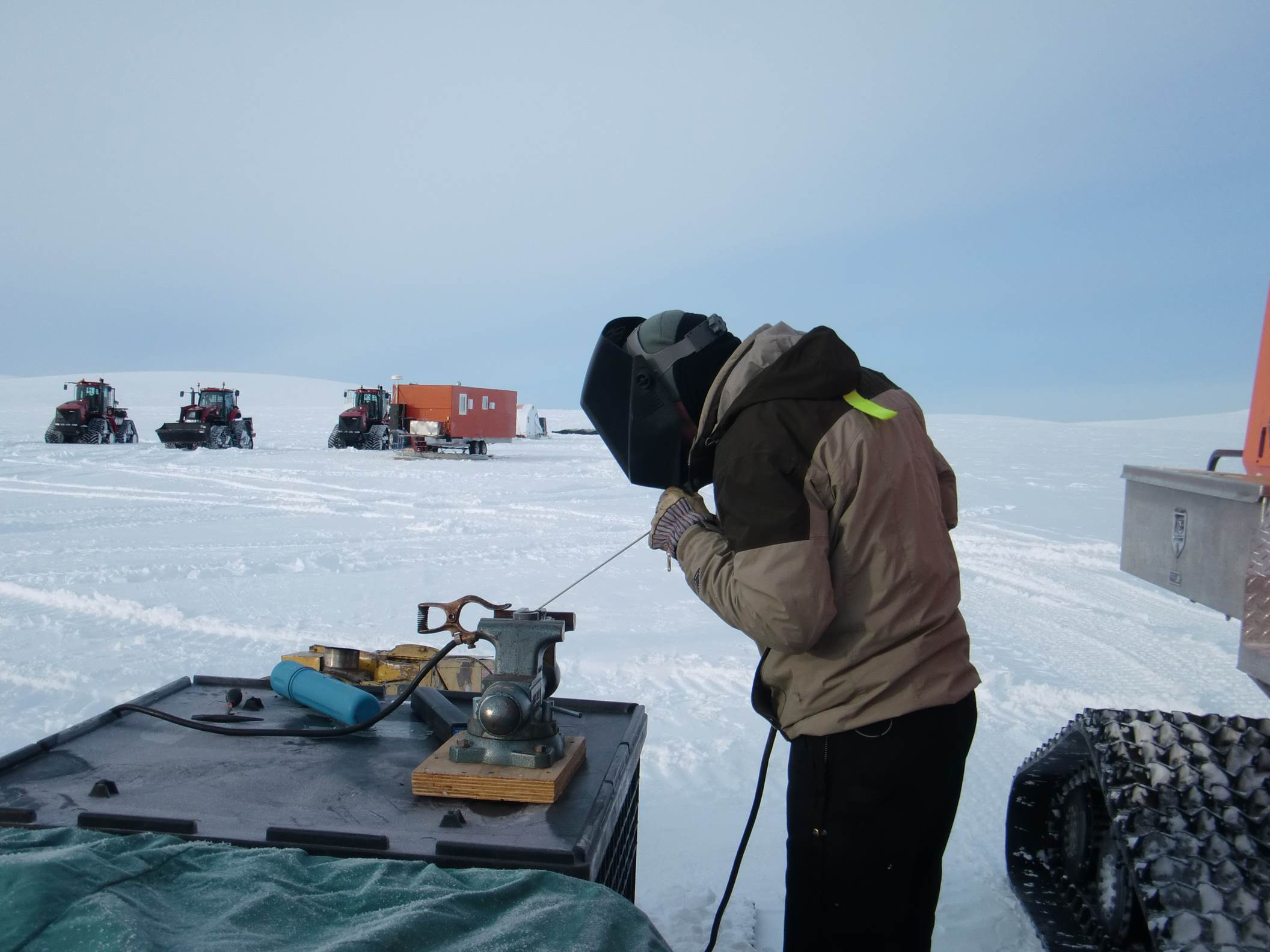 After dealing with a series of mechanical issues, the GrIT team has resolved the majority and is making great progress. The team is resourceful, equipped, and experienced. In this picture from 2012, Robin Davies prepares for some field welding out on the ice sheet. Photo: Shep Vail