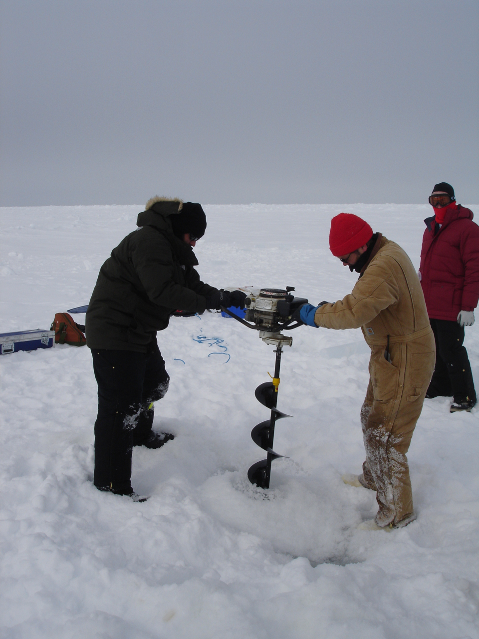 Craig Aumack and a colleague drill ice cores in the Arctic. Photo: Craig Aumack