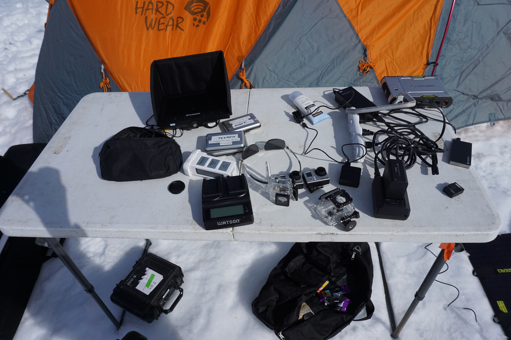 """Tools of the trade: the filming equipment is gathered on a table outside the team's """"Mountain House"""" base camp."""
