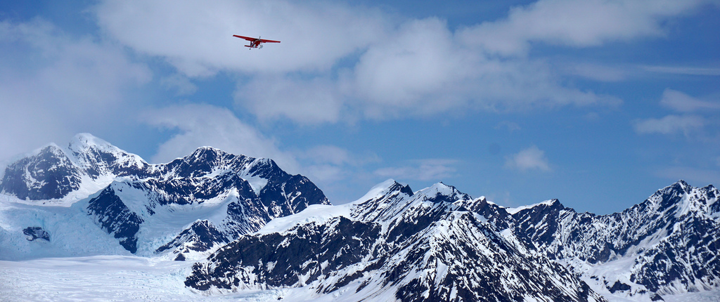 Coming in for landing!  A plane begins the descent onto the Ruth Glacier airstrip. The primary mode of transportation in these mountains is via bush plane.