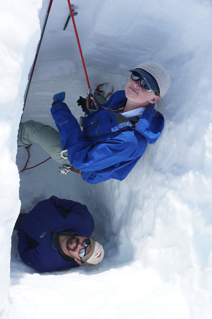 Abi Bradford and Seth Campbell deep in the snow pit gathering samples for density and isotope measurements.