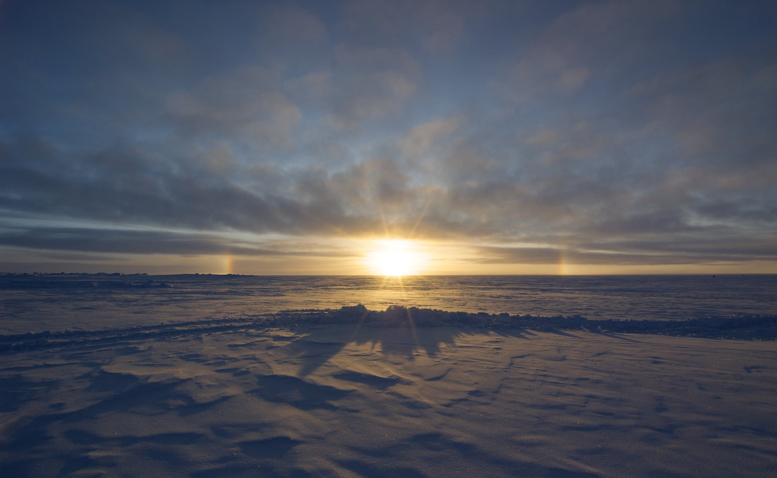 The cloud cover over the Greenland Ice Sheet is the focus of University of Colorado post-doctorate researcher Ryan Neely's ongoing project. He's using novel LiDAR data collection techniques to better understand how clouds and other particles suspended in the air affect the ice sheet's energy budget. Photo: Ryan Neely