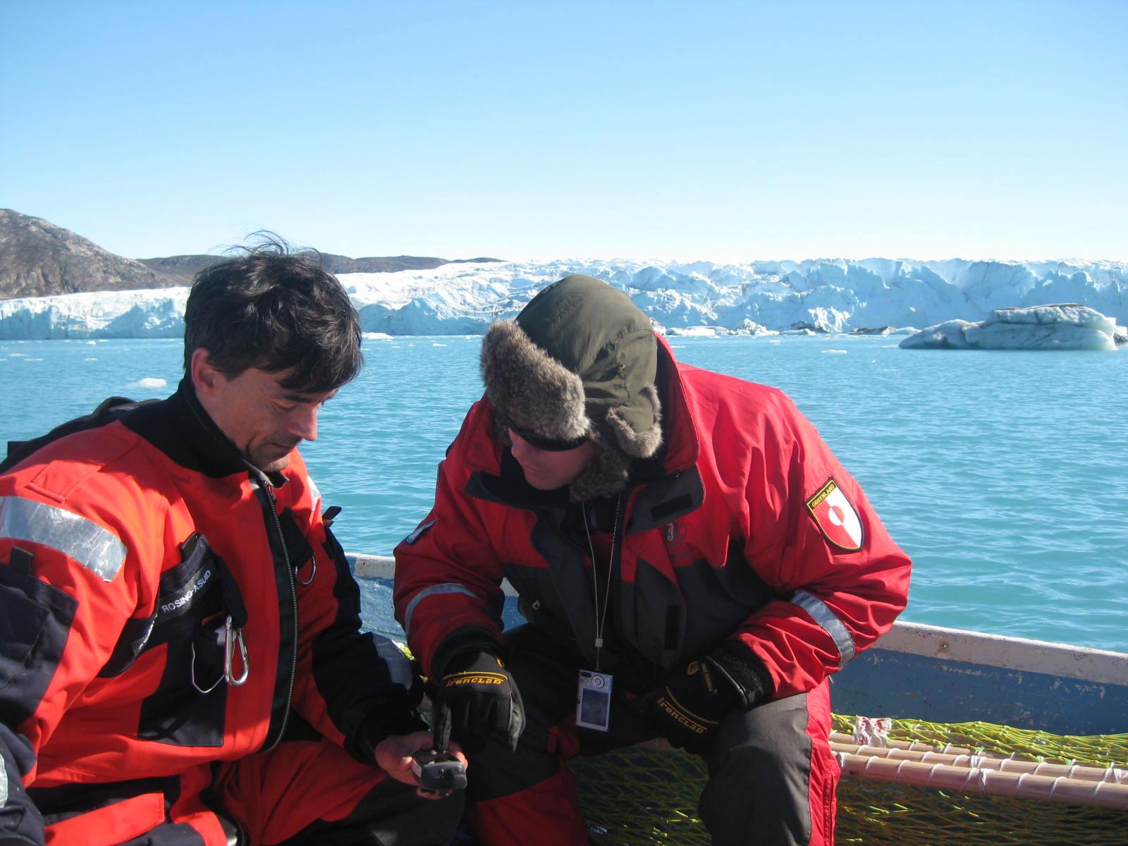 Dr. Aqqalu Rosing-Asvid, Greenland Institute of Natural Resources (left) and Professor David M. Holland, NYU (right), examine data. Photo: Denise Holland