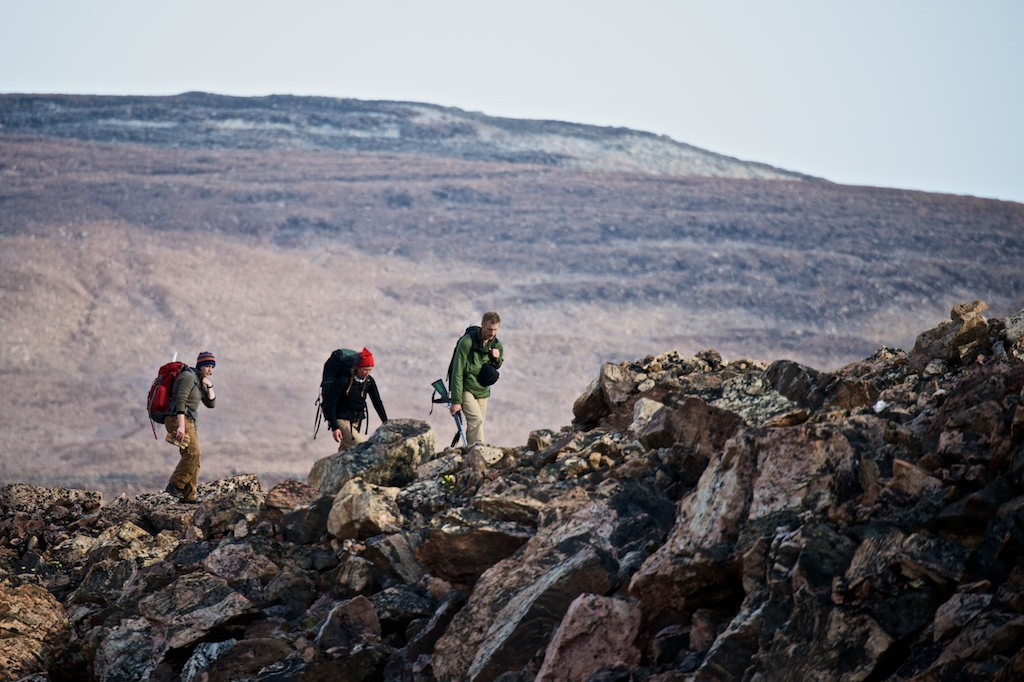 Glacial geologists Maggie Jackson (left), Lauren Farnsworth (center) and Gordon Bromley (right) hiked long miles over bouldery terrain every day, in search of ideal glacial features to be sampled for cosmogenic surface exposure dating.  Dates on glacial landforms help to clarify how the Greenland Ice Sheet and local ice caps responded to past climate change in the Thule region. Photo by Alex P. Taylor.