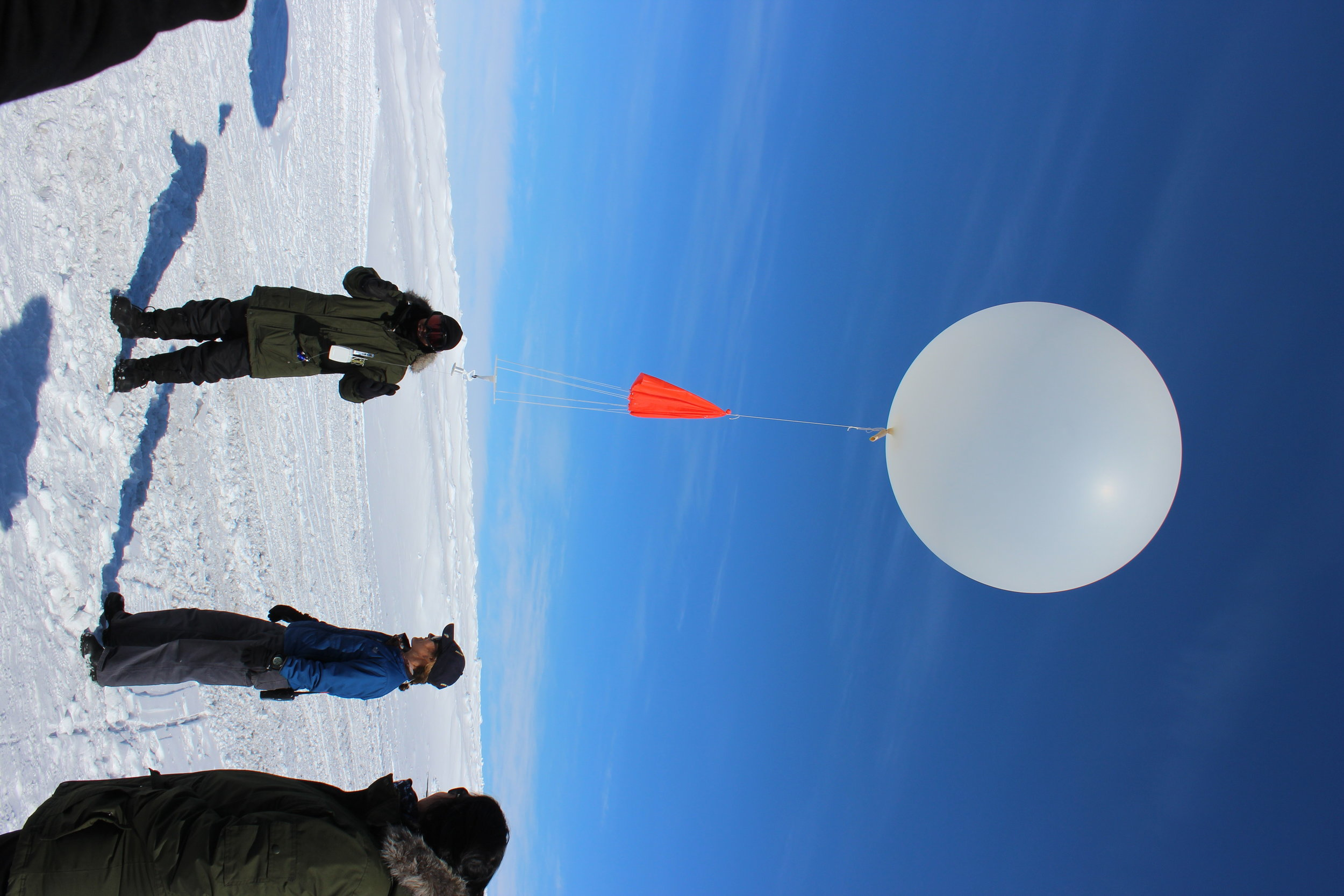JSEP students learn about weather balloons on the ice. JSEP introduces select high school students to a variety of National Science Foundation-supported Arctic research.