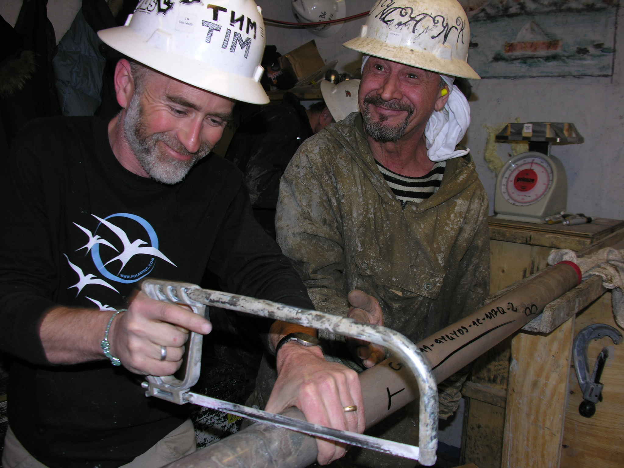 Tim Martin and Roman Nafjrova processing a recently extracted core sample from Lake El'gygytgyn. Photo: Tim Martin, courtesy of ARCUS