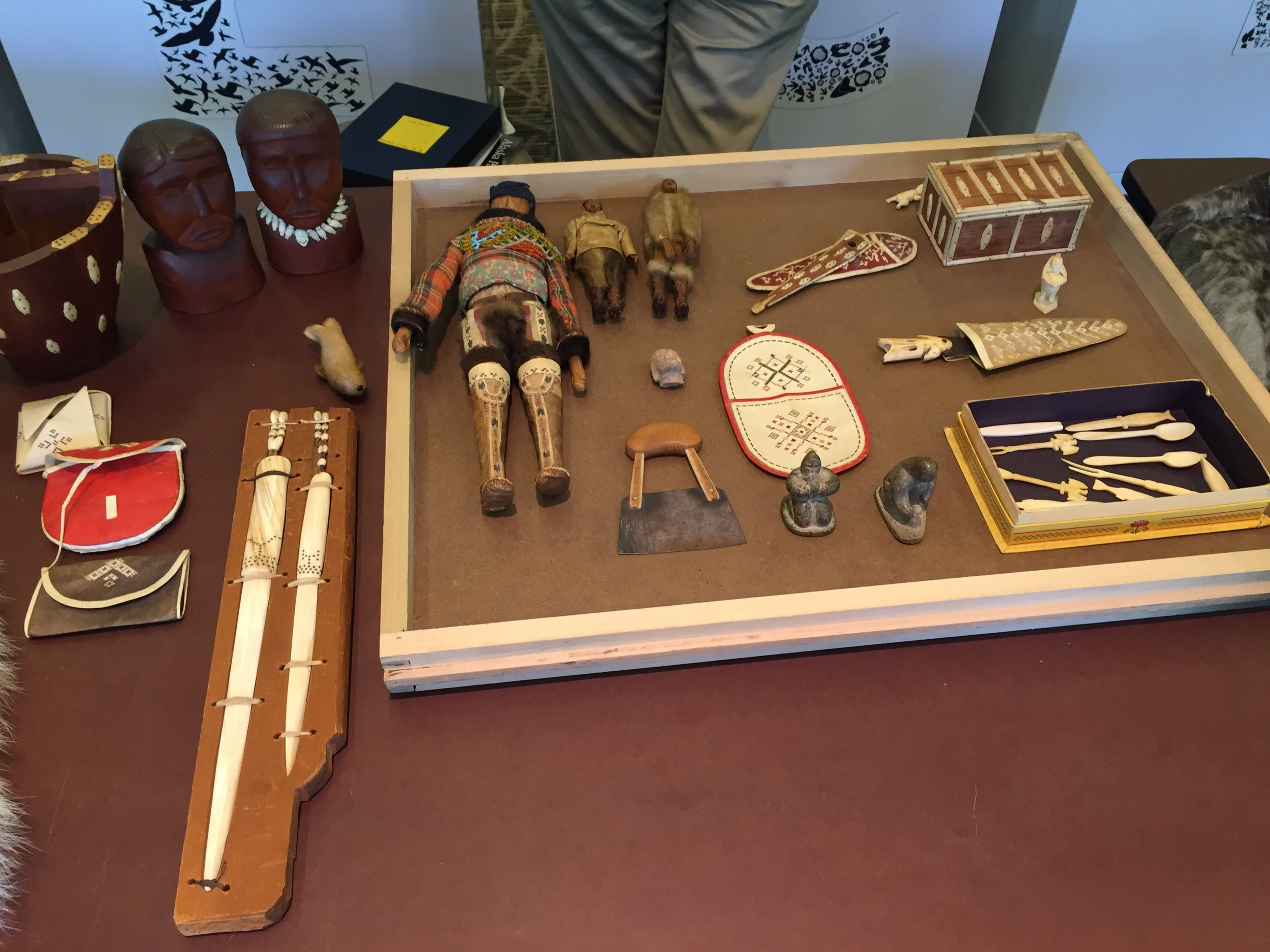 These objects on display in Q?rium are from East Greenland. They were collected by a U.S. Airman working in Greenland during World War II. They are crafted from narwhal tusks and were made by locals specifically for tourists and other visitors.