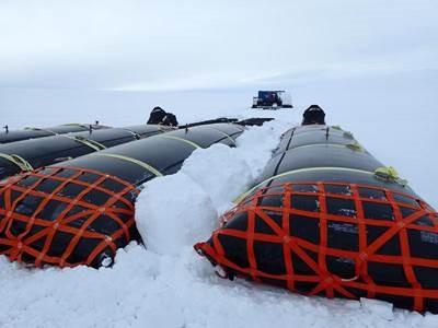 Snowballs accumulating on the fuel bladders. Photo: Robin Davies