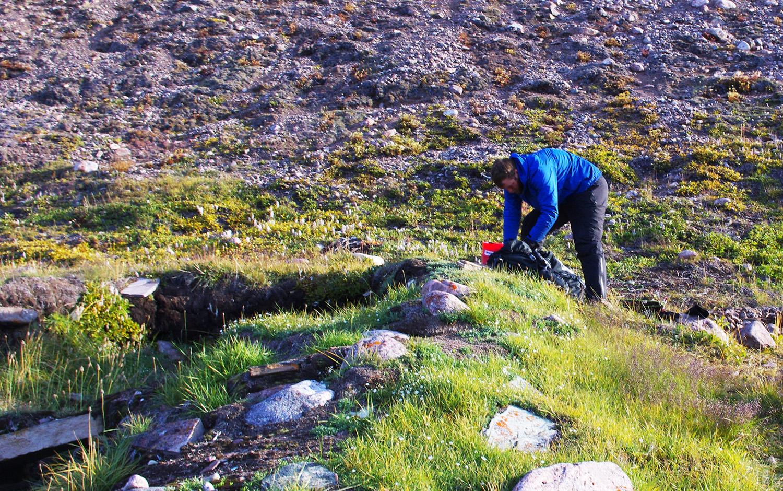 Archaeologist Justin Junge works to recover artifacts at Iita, Greenland. Photo: John Darwent