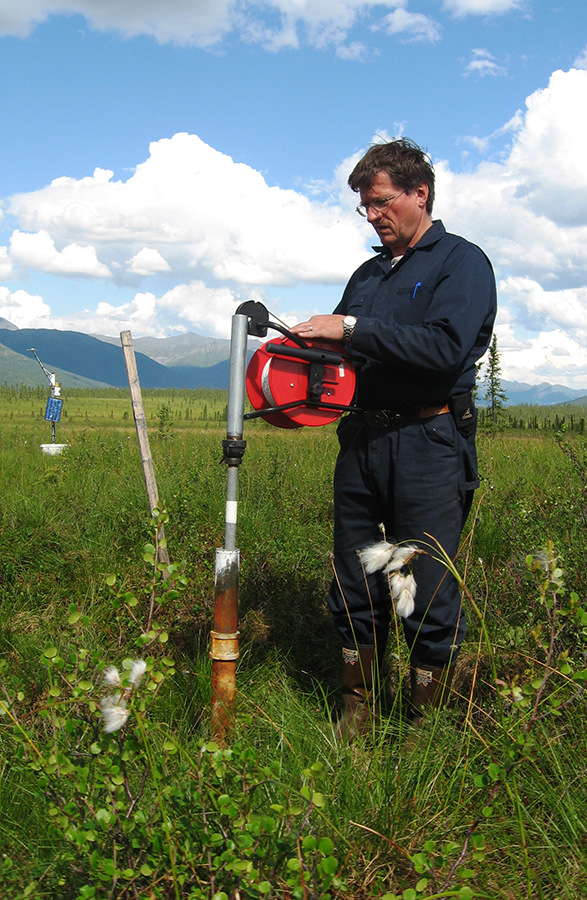 Scientist Vladimir Romanovsky studies changes in the permafrost around the North Slope of Alaska in 2007. Warming climate is causing the active layer – the upper portion of the soil that thaws and freezers each year – to deepen. Warmer permafrost is partly allowing coastal erosion around the Arctic, endangering archaeological sites. Photo: Vladimir Romanovsky