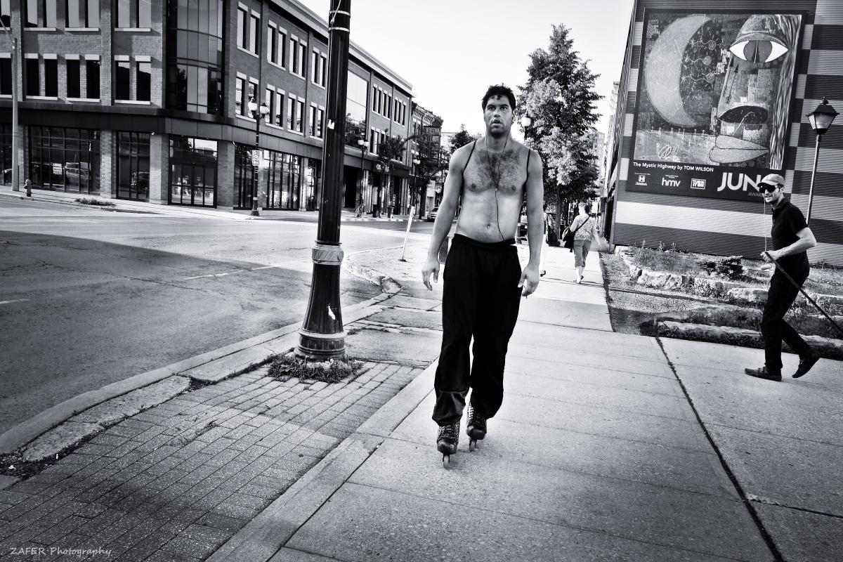 shirtless man on skates James North 1 sm.png