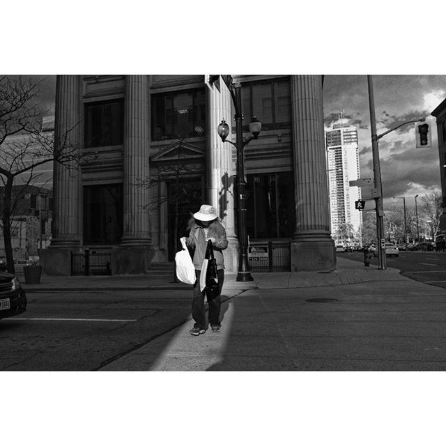Chasing pillars of light - James and Main Street, Hamilton Ontario. . . . #HamOnt #streetphotography #ricohgr #ricohgr3 #candidphotography #streetphotographymagazine #streetphotography_bw #canpubphoto #streetleaks #life_is_street #storyofthestreet #blooryorkville #streetphotographyinternational #grist #everybodystreet #streetphotographersmagazine #burnmagazine #streethunters #streetstories #blackandwhitestreet #zonestreet #fromstreetswithlove #28mm #Streetphotographyworldwide #streetclassics #streetsgrammer #inpublic