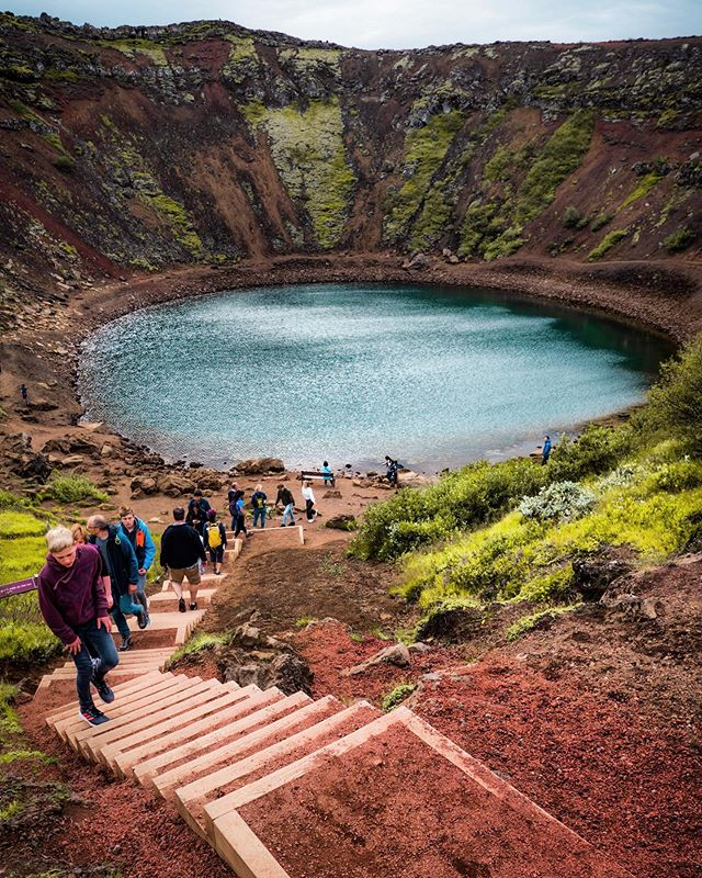 Whoa! Hands up if you've been to Kerið? 👋🏽 You can find it on our golden circle and volcanoes tour 🌋  The red rock is volcanic, and the green is moss. The water is so blue due to mineral deposits ❤️💚💙 📸: @jarvismj . . . . #iceland#travel#wanderlust#explore#outdoor#mountain#tour#travels#holiday#vacation#nature#naturephotography#landscape#landscapes#landscapephotography#exploring#wander#roam#roaming#life #kerid #craterlake #crater