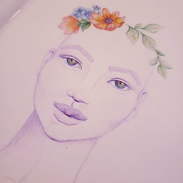 "She doesn't have any hair yet, but I'm pleased with the progress on the flowers and her eyes. I've always wanted to draw and paint portraits, but I held myself back with limiting beliefs such as, ""I'm not good enough"", ""I suck at drawing faces, ""I will never draw faces the way I see them in my mind"". I had been setting myself up for failure and disappointment. Instead of practicing I just told myself I would never be good enough, so why bother. And I didn't bother. :( . . But recently I've started to take the approach that none of this is precious, it doesn't have to be NOR DO I WANT IT TO BE perfect, so why not try?! If I play and have fun and try new techniques and practice (then practice more) the techniques that I enjoy and are working for me, I will, in time, achieve the look I see in my imagination. . . Most of us are far too critical of the beginning stages of a new muscle we are developing and I don't just mean in art. We do it with exercise, we do it with learning a foreign language, we do it when trying to learn ANY new skill and it's a bad habit we all would benefit to let go of. . . We've heard it many times - it takes doing something 100 times before you produce something you're really proud of and can do again with consistency. This month I started drawing & painting faces again, so I've got about four more months before I really get the hang of it. And you know what? I'm cool with that. So I'm taking my own advice - hunker down, do the work, keep going even when you hate what you've done, learn from each step of the process and never give up on the things your heart desires most! . . While you're at it, celebrate the things you did that you really like!!!! For me, I'm gonna celebrate her eyes, ears and the flowers. :)"