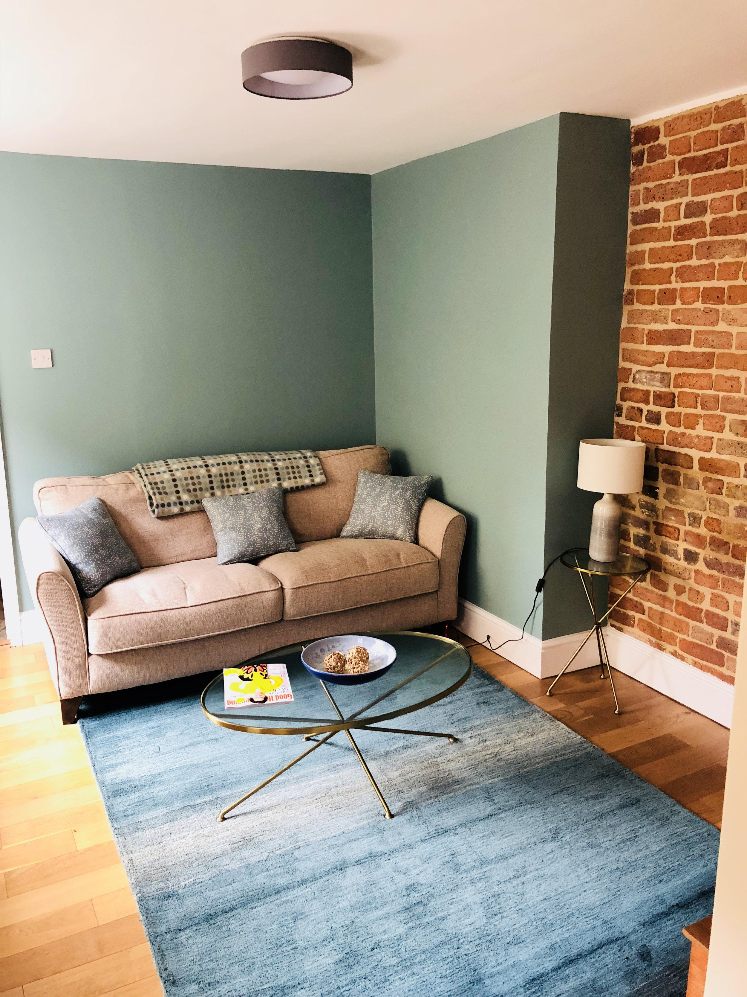 - The result is a beautiful warm and cosy snug. The original external Victorian wall was exposed by using a method called sand blasting, that removed all the paint and exposed the beauty of the brick underneath. The walls were painting in Oval room blue by Farrow and Ball with a gorgeous teal rug that compliments the brass furniture.