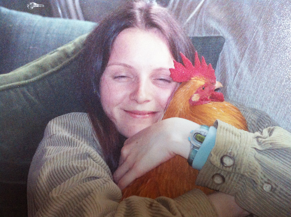 """An eleven-year-old me and my first """"pet"""" rooster, Bonnie. Roosters like Bonnie are perhaps the most invisible captive birds in modern society, with the majority silenced shortly after leaving the shell. Those remaining survivors are often labeled nuisances and banned in municipalities, and some find themselves shredded alive for bloodthirsty sport. A lucky few find their way to loving flocks or to   sanctuary"""