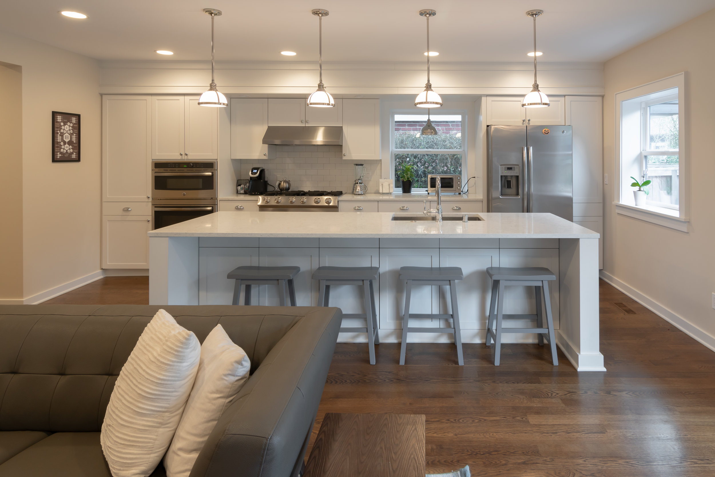 We often integrate the kitchen with the other main living spaces, to allow the family to stay connected while in the different communal spaces on the main floor of the house.