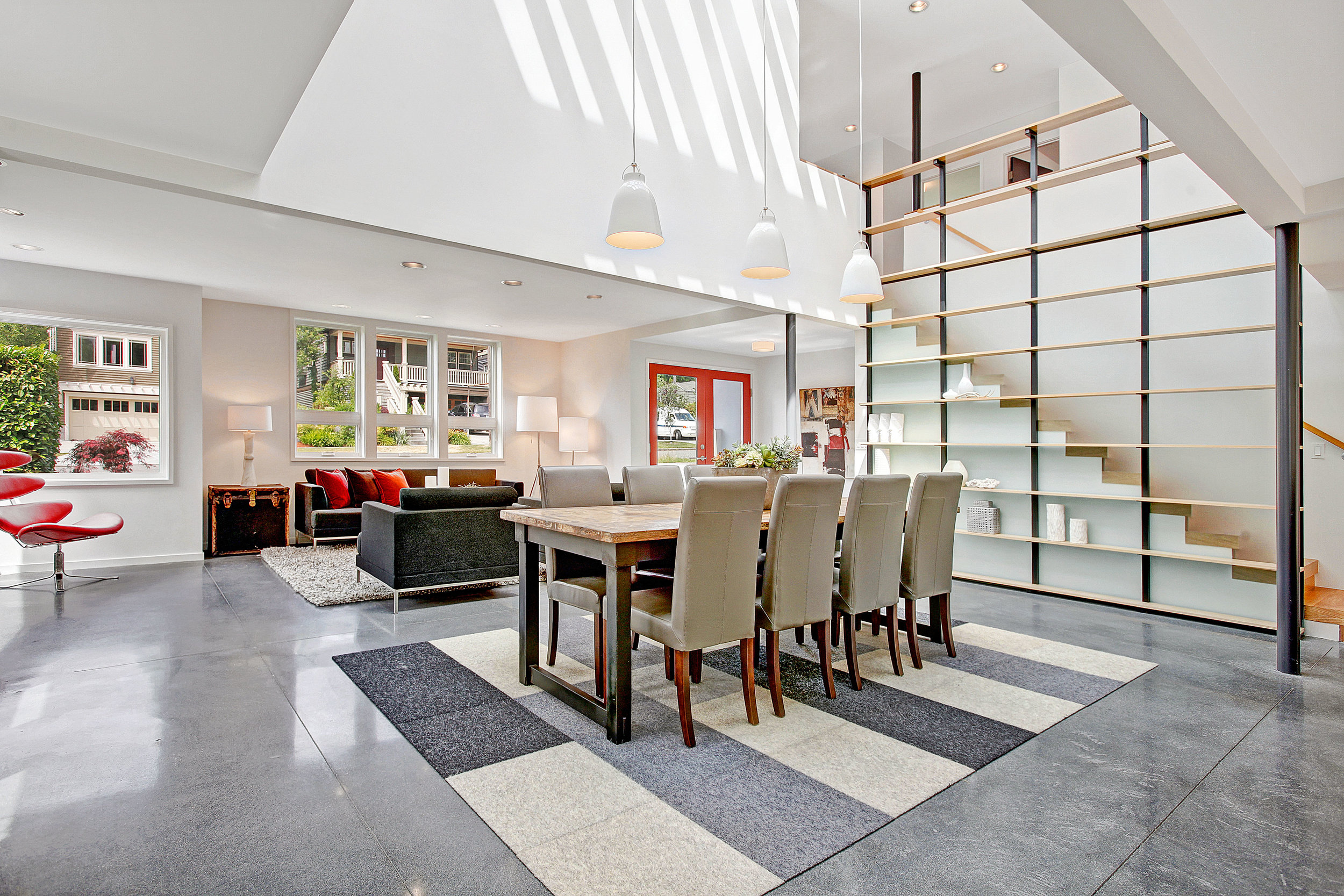 The double height space in the center of the  Hawthorne Hills Sliding Volumes House . We made a large double height volume at the stair that emphasizes the dining area below.