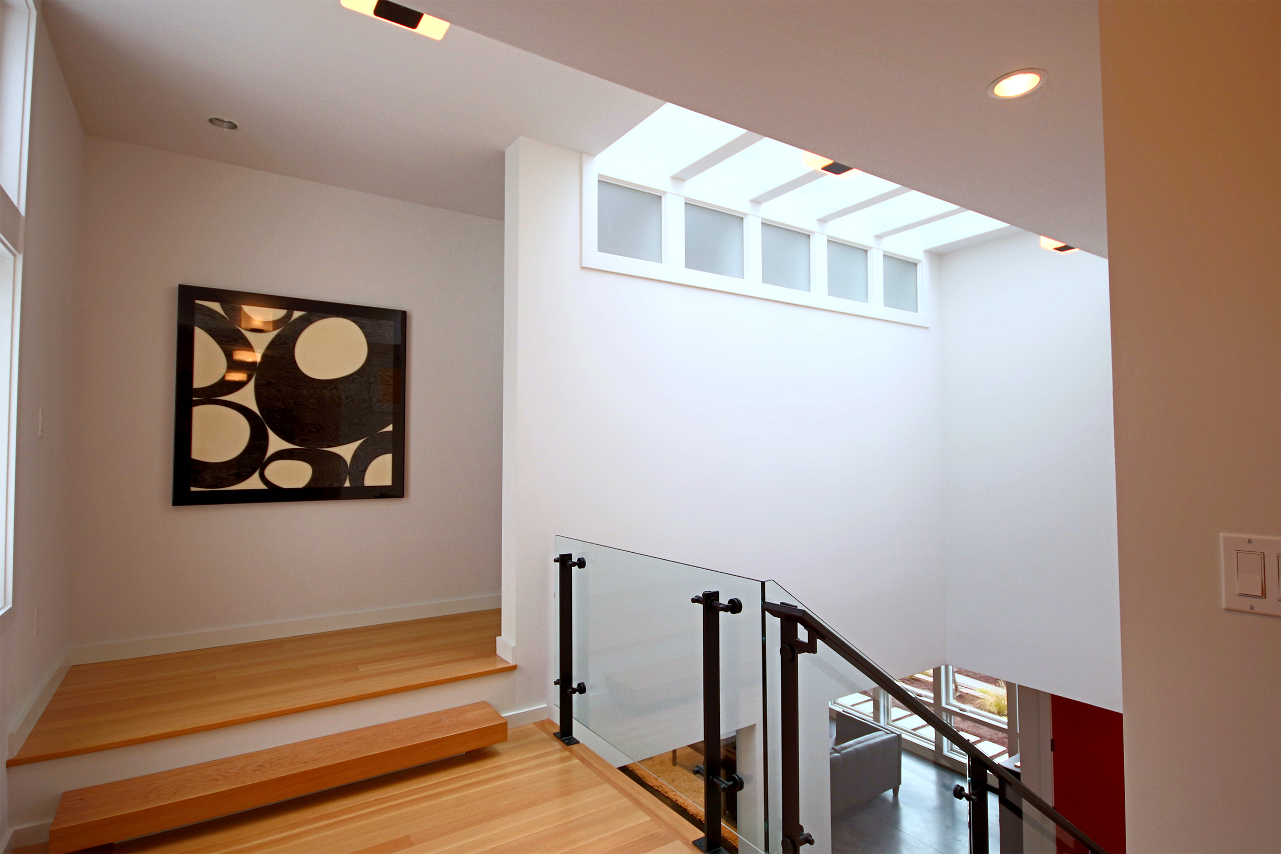 Here again, we chose to use the stair space as an opportunity to create a larger double height space in the  Double Box House . In this house, the space is closer to the entry, but still in the center of the building, so it brings lots of natural light down into main spaces that otherwise would be dark.