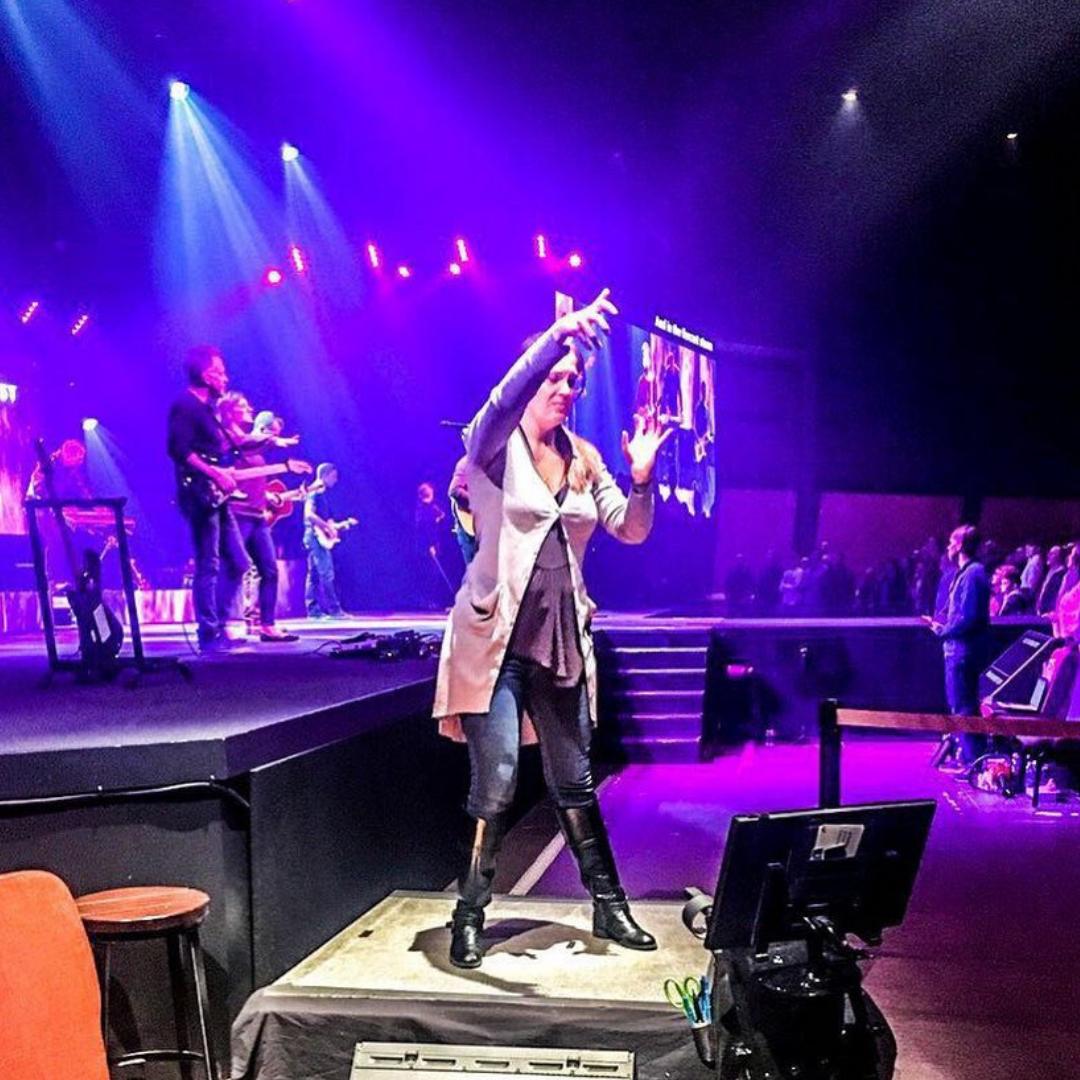 Nicki Runge interpreting at church with sign language