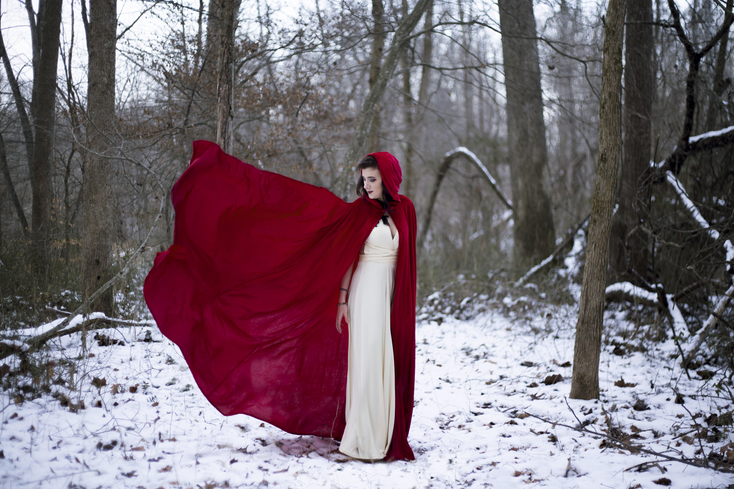 Little Red grew up. She finds comfort in the dark woods now.