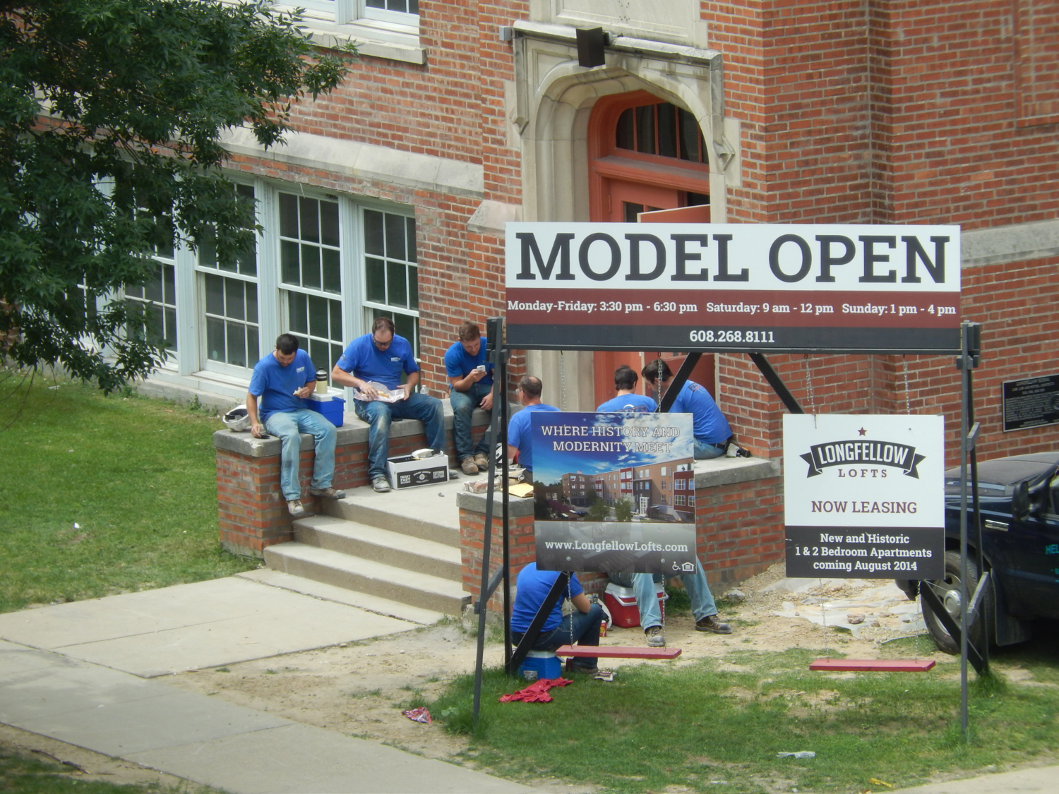Construction crews take a break during the rehabilitation of Longfellow School in Madison to residential apartments. The project used Wisconsin's new 20% historic tax credit in 2014 to increase Madison's property tax base, create jobs, and increase housing options, and retain an important and irreplaceable piece of the city's history.