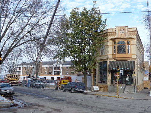 The Pinkus-McBride commercial building anchors a corner of a six-pointed intersection in Madison, and provides a sense of the neighborhood's history while a new apartment building rises behind it.