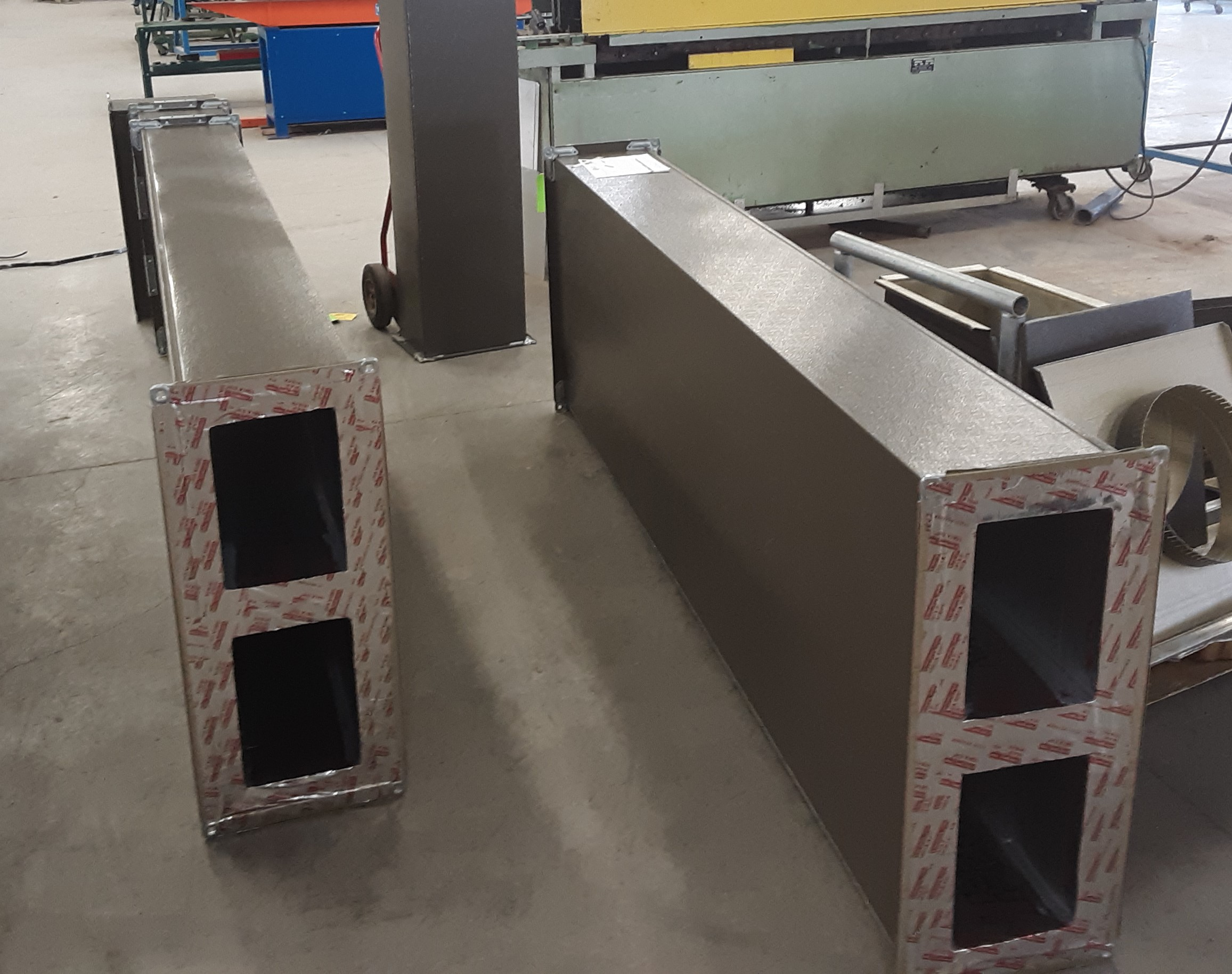 The engineer also liked the concept of utilizing two ducts into one exhaust system for ease of install and limiting the amount of ductwork showing on the side of the building.