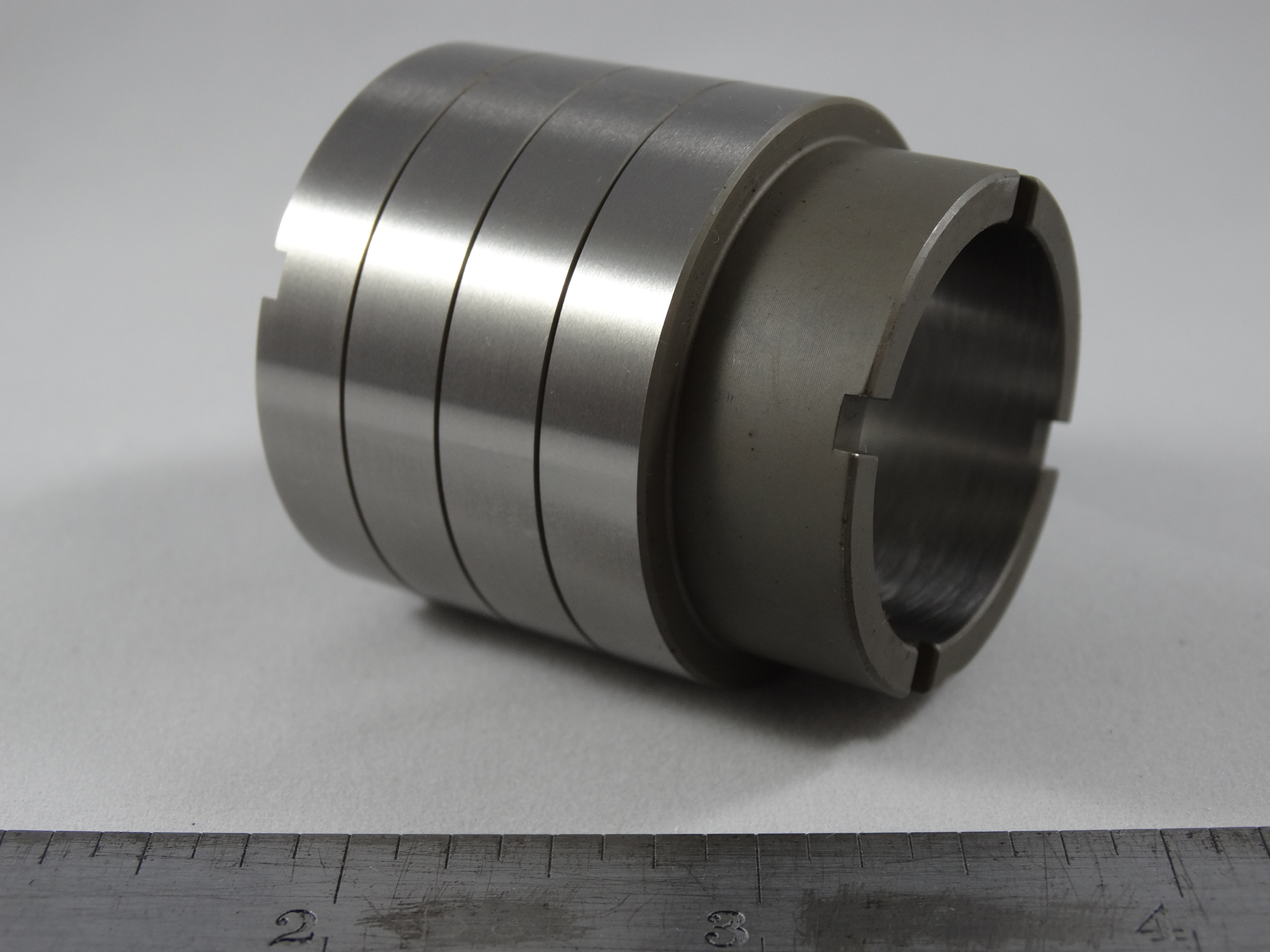 CNC Turned Sleeve Part - Material: 8620 Alloy Steel - Heat Treated and Centerless Gound O.D. and Honed I.D.